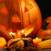 Scarved pumpkin with candles