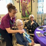 Suzanne putting beads on residents!
