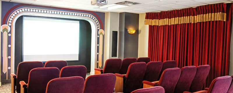 Walk only steps to your own private movie theater.