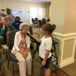 Grace interviewing residents on their favorite Girl Scout cookies and trivia!