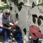 Gloria playing the Milking the Cow game