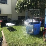 Elise laughing as our Community Life Assistant, Kamron, gets dunked