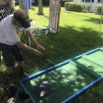Mark playing the Hole in One game