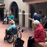 Independent Living residents doing morning stretches at Mission Inn.