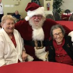 Resident Council President, Joyce, and Marge with Santa.