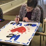 Residents made signs to surprise the Veterans at the Welcome Home Ceremony.