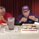 Larry and Dick working hard to get those donuts down!