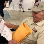 Veterans on these flights receive many letters from near and far, including from friends and family and Senate. As we waited to surprise him with the Welcome Home Celebration, he was presented with the many letters to keep him busy!