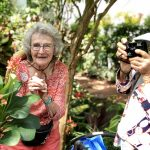 Beautiful ladies in the Butterfly Conservatory taking photos