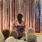 Ms. Betty Lewis singing her surprise performance song