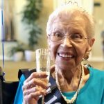 Queen for the day, Pearl, celebrating 100 years with champagne & friends