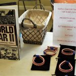 The 50th Anniversary Edition of WWII raffle item and bracelets contributed by Celebrate Outreach