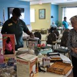 Associates and residents browsing the sales