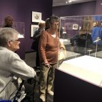 Residents listening to our docent explain the starfish pieces.