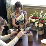 Madeline & Vikki (not pictured is Robert,) working diligently on the creations for the centerpieces.