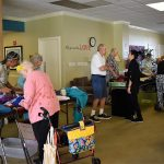 Associates and residents browsing the sales - there was so much to choose from!